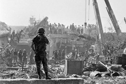 Rescuers continue to probe the wreckage of the U.S. Marine command, Monday, Oct. 24, 1983 in Beirut building that was destroyed on Sunday by a terrorist bomb. In the background can be seen the control tower of the Beirut airport. (AP Photo/Zouki)